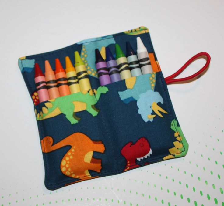 Crayon Roll Dinosaurs Crayon Rollup, holds up to 10 Crayons Crayon Roll Party Favors by FrogBlossoms on Etsy https://www.etsy.com/listing/157997672/crayon-roll-dinosaurs-crayon-rollup