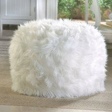It's like putting your feet up on a cloud! What a fun, fuzzy, furry spot to sit and relax! Weight 2 pounds 19 inches in diameter x 11.75 inches tall Polyester and polystyrene