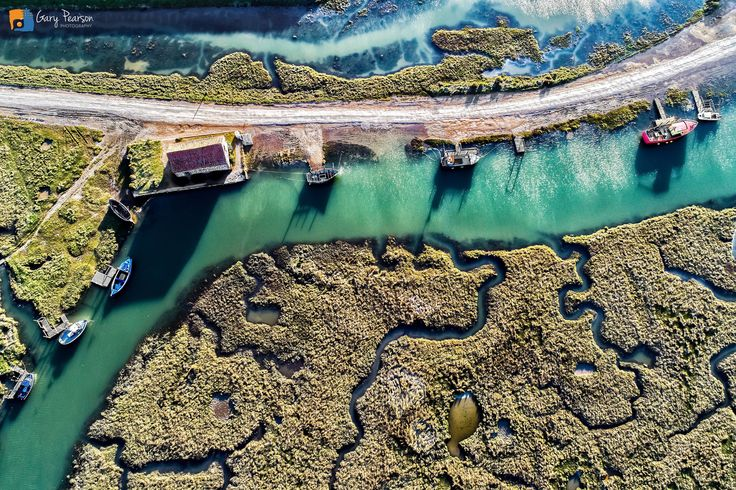 https://flic.kr/p/UGddSj | Thornham Staithe from above | Taken an hour before sunset when the shadows were long giving better definition of the meandering creeks and making the water appear to be turquoise blue.