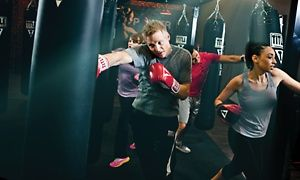 Groupon - $ 18 for Two Weeks of Boxing and Kickboxing Classes at Title Boxing Club ($50 Value) in Arden Hills. Groupon deal price: $18