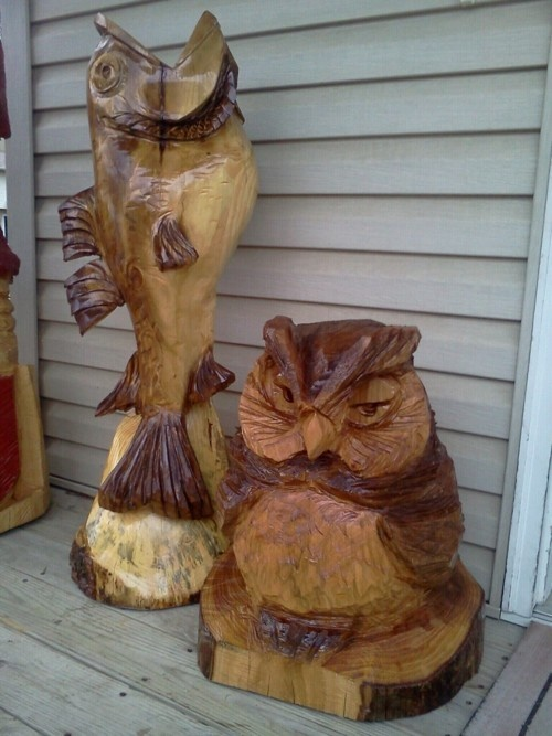 Fish and owl chainsaw carvings out of water