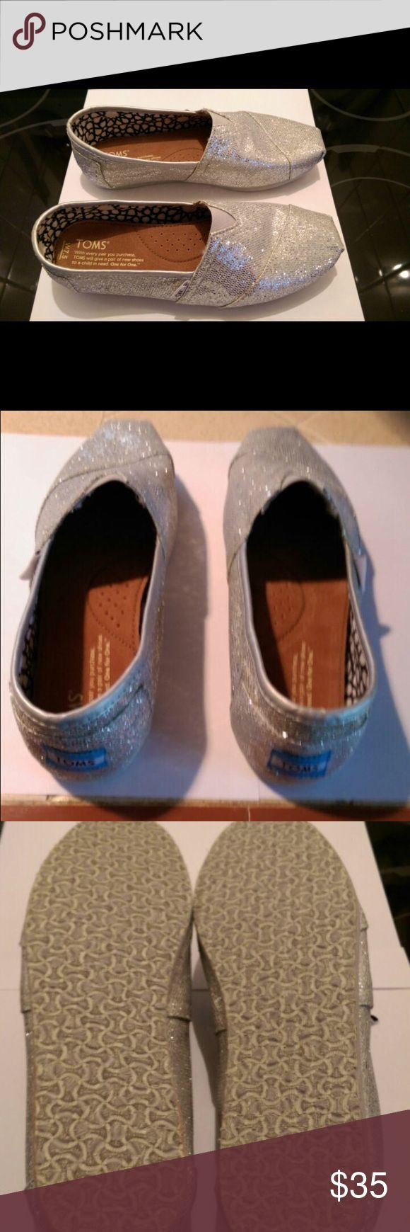 New Glitter Toms New, never worn, silver glitter Toms, size 7.5. Open to offers. TOMS Shoes Sneakers