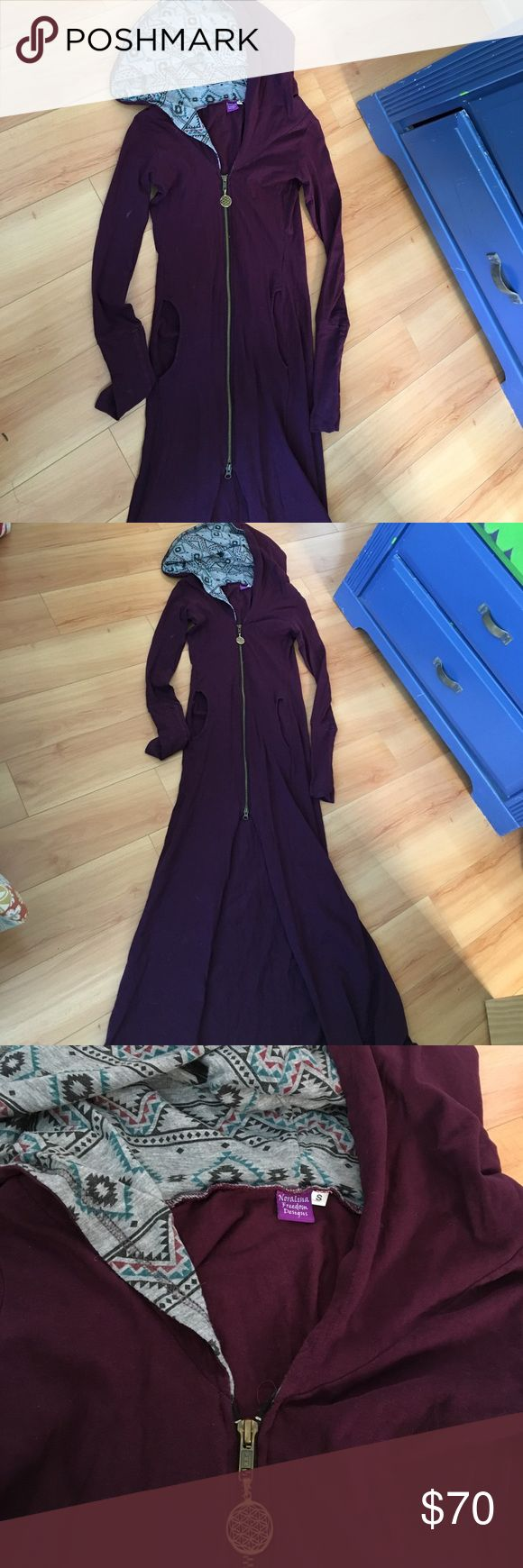 Festival Jacket/dress Long purple jacket/dress. Worn once at a festival. Awesome hooded pattern, flower of life zipper, thumb holes at the wrists. I'm 5'5 and it hits me right above my ankles. Under blackmilk for views. Blackmilk Dresses
