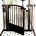 Wrought iron indoor dog gate will keep your dog safely contained in a specific area while looking attractive in your home