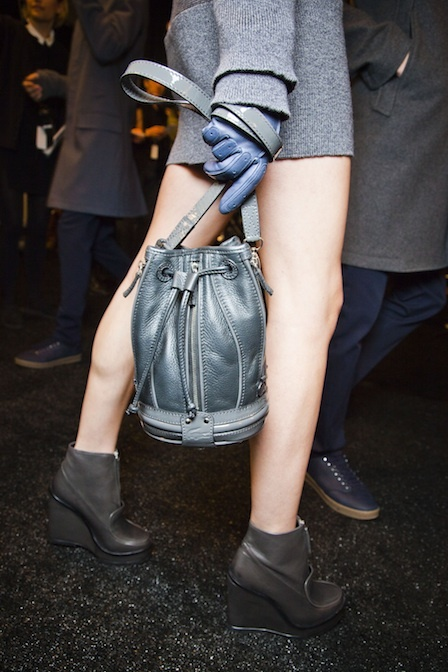 Blue-grey bucket bags with patent leather straps popped up at Lacoste