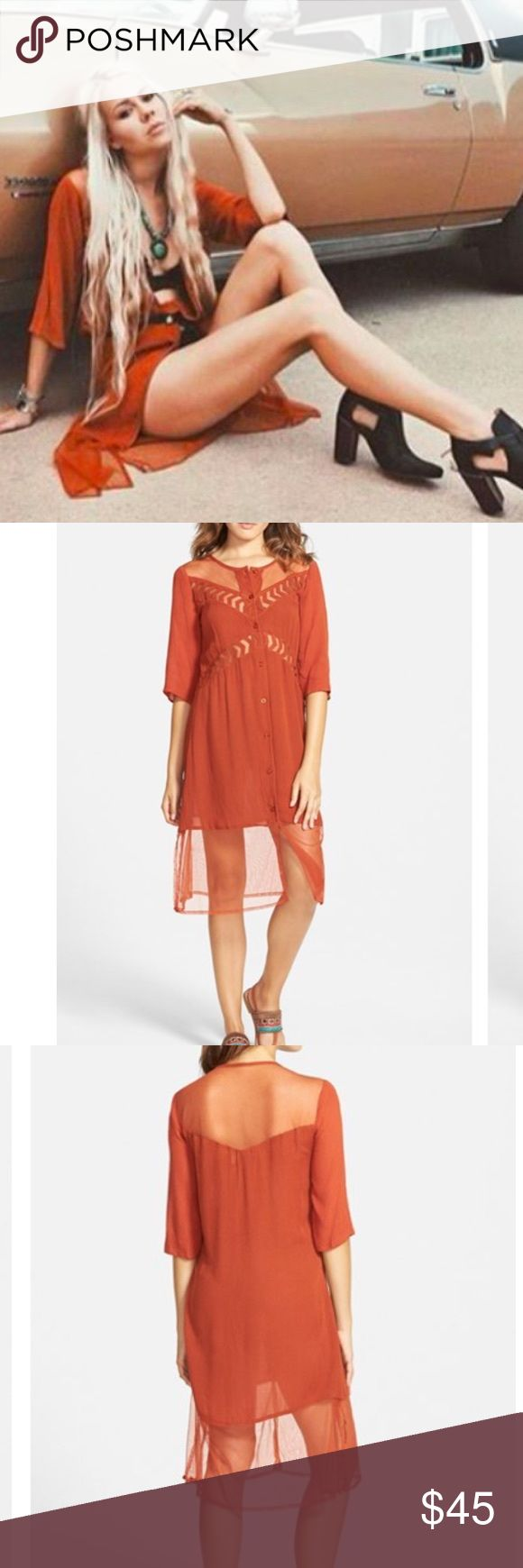 """Listing Volcom Boho Midi Dress Volcom Highway Child Boho Midi Dress. Sheer insets at the yoke and contrast hem lend flirty, skin-baring details to a shirtdress framed with chic elbow sleeves in this unique, super boho rusty color. Front button closure. 100% viscose. Approx. 40"""" long. Armpit to armpit approx. 18"""" across laying flat. Definitely has an oversized feel, so I think it'd work for XS-S IMO. Stock photo from Volcom catalogue shoot. Volcom Dresses Midi"""