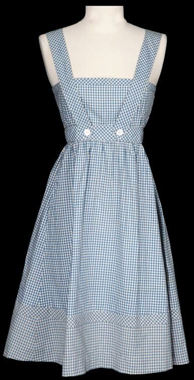 The blue-and-white gingham dress designed by Adrian for Judy Garland in The Wizard of Oz (1939).    From Profiles in History