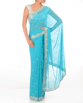 #Exclusivelyin, #IndianEthnicWear, #IndianWear, #Fashion, Turquoise Blue Sari with Crystal Stones
