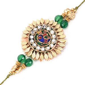 The look of this Rakhi thread is extremely gorgeous. The centerpiece is surrounded with golden colored leaves and and is studded with sparkling stones, in the center there is an image of peacock made with zardozi work. Send Rakhi to India to your brother via Giftblooms.com and celebrate the festival of Rakshabandhan.