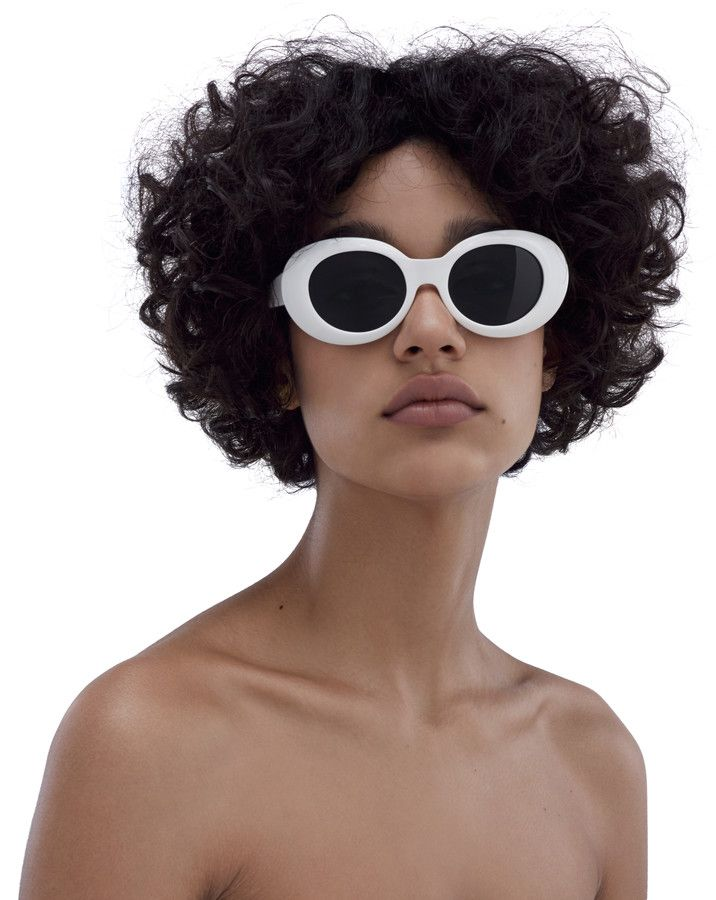 Oval Sunglasses - a very popular style of glasses that the lenses are oval shaped and come in a varitey of sizes and colors. This style would be ready to wear and moderate budget