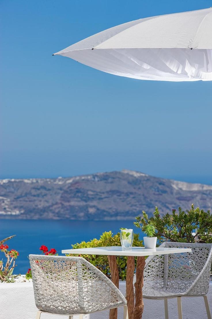 The endless deep blue flirting Aegean sea.A view from the Mill Houses Studios,Santorini. @www_tge_gr