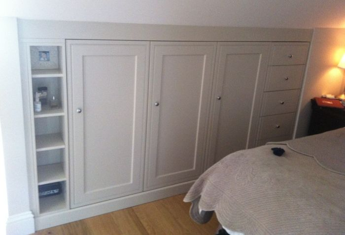Bespoke in-frame shaker bedroom furniture from Anthony Mullan furniture, designed to go in the eaves to maximise storage.