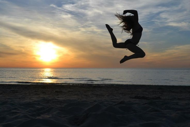 Katie McMahon doing gymnastics on beach during sunset #photography