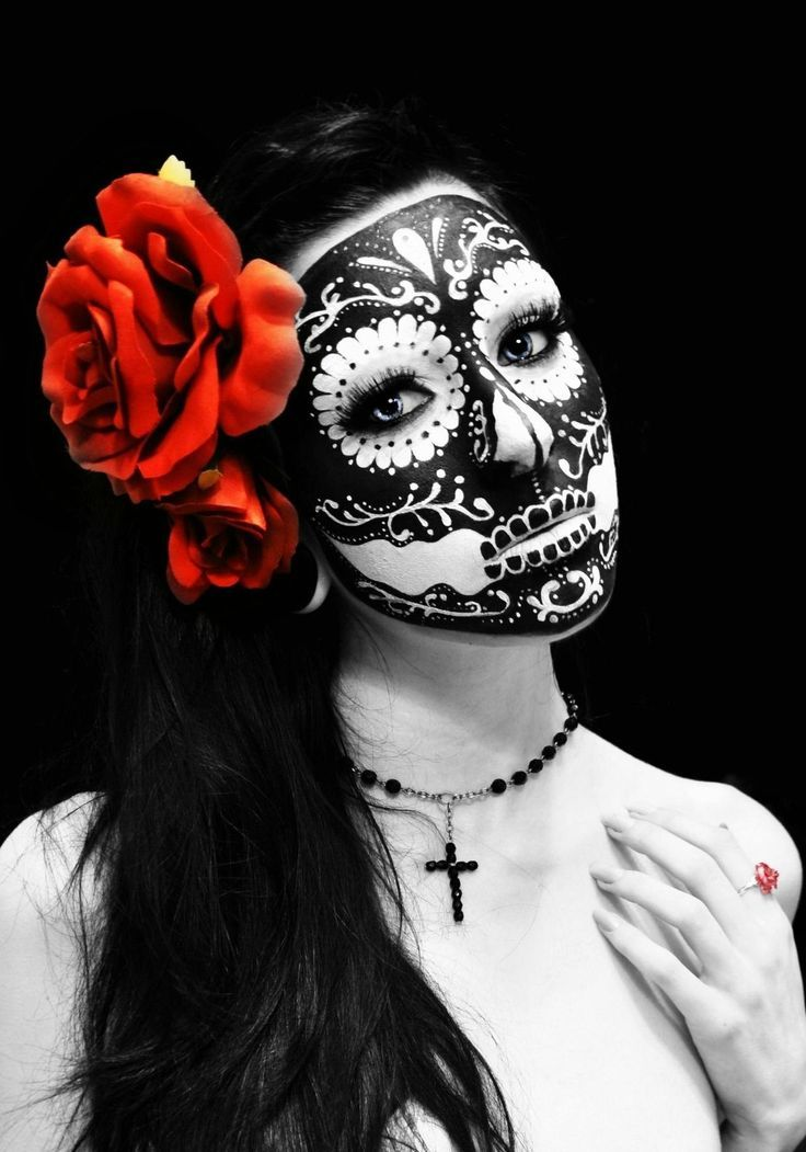 this is a stunning interpretation of the sugar skull for Dia De Los Muertos. i can't even imagine how they thought this up. i'm completely floored and also mesmerized, wondering who it is she's thinking of. and that flower - wow!