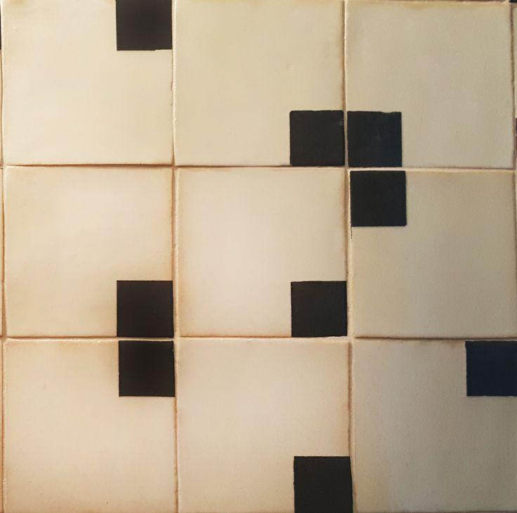 Black and dark grey engobe under clear glaze on 15x15cm handmade tiles.