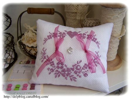 Ring pillow for a wedding.  Since it is hand embroidered, the color could match almost any choice.