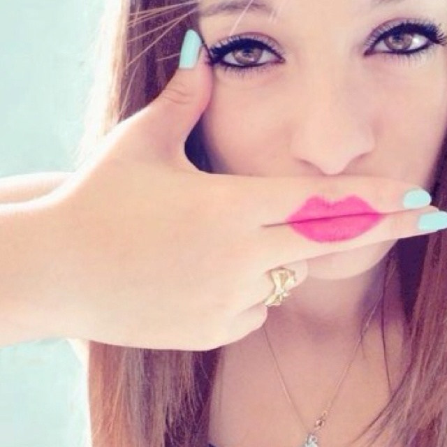 I love her eye makeup and nail polish...if she wasn't doing that with her hand it would be great.