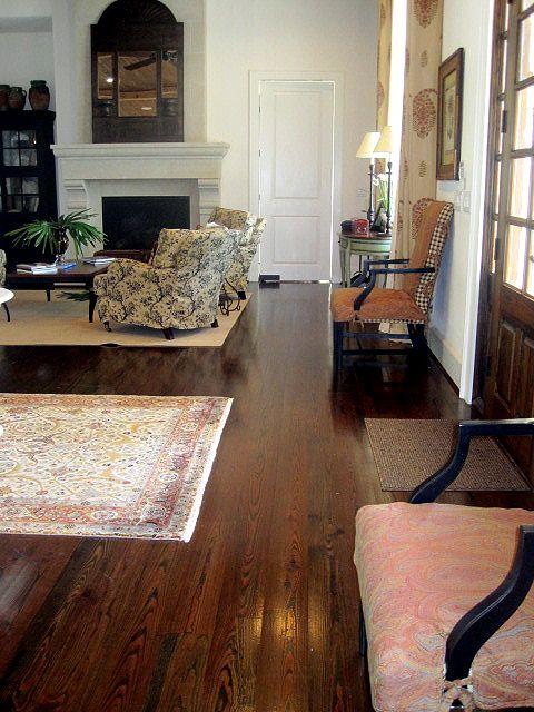 Jonni Vermeulen's River Recovered Antique Heart Pine flooring with a dark walnut stain.
