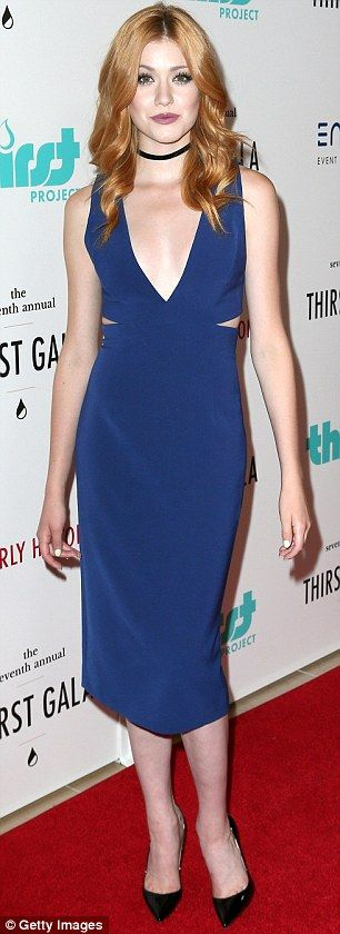A fiery pair: Redhead Katherine McNamara showcased her cleavage in a plunging blue dress w...