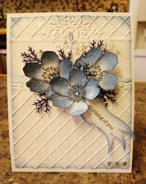 Blue Flowers  Stamps: SU!  Paper: Cheap Walmart Cardstock, SU!  Ink: Tim Holtz Distress Ink Faded Blue Jeans  Accessories: MS Pine Branch, Doohickey Die, Sizzix EF, gems, Stickles