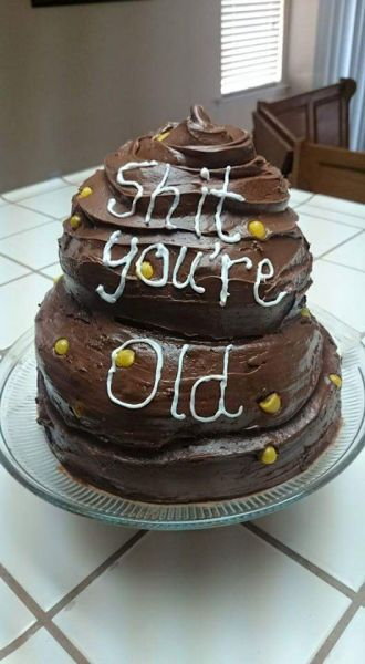 Getting old sucks and receiving a birthday cake that looks like a corny turd doesn't help.