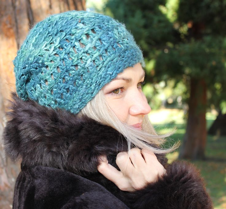 Slightly slouch hat in emerald. 100% hand spun and hand dyed Mulberry Silk.