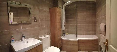 This modern style bathroom looks very fashionable with its wooden finished furniture by Dawn from Stockport #VPShareYourStyle