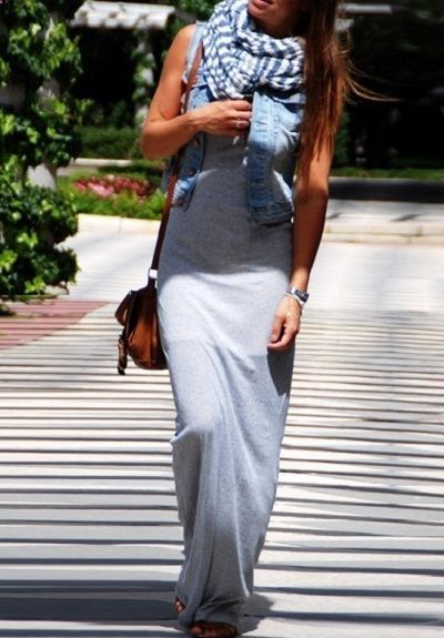 a grey maxi dress is a comfy option that combines with a denim vest and scarf fo