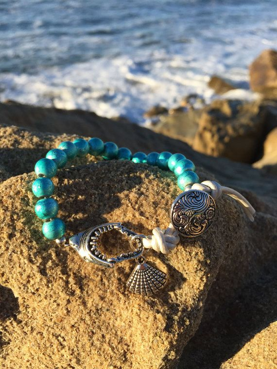 """Life Boho - Teal Round Beads, Genuine White Leather Silver Shark Teeth, Silver Shell Bracelet, Teal Bracelet, Beach Bracelet, Shell Beads, FREE SHIPPING  These Colors Mirror the colors of the Ocean in Hawaii.  • Adjustable Bracelet - Starts at 7"""" • 8mm Teal Czech Beads • Genuine White Leather • Silver Shark Teeth Charm • Silver Shell Charm • Silver Ornate Button  Colors are inspired by the beach colors and are very beautiful.  ***FREE SHIPPING***"""