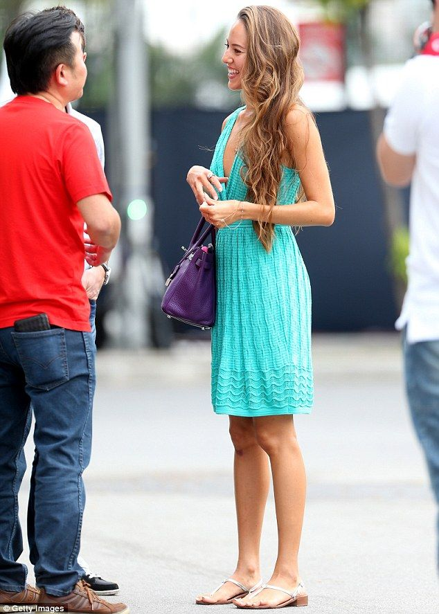Turning heads: Jessica Michibata looked positively breathtaking in a bright aquamarine minidress as she turned out to support racing driver ...