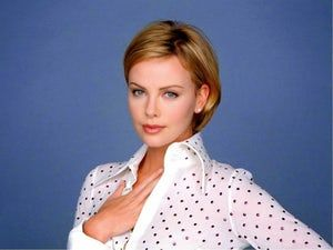 Photos of Charlize Theron, one of the hottest girls in movies and TV. Currently ranking number one on the world's most beautiful women, Charlize Theron is also stunning in a bikini. Charlize's first major role was in the movie 2 Days in the Valley. She has since been in such movies as Th...
