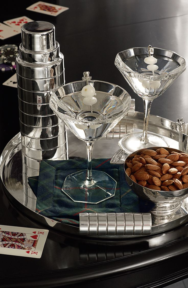 A deco-inspired cocktail moment ups the ante for poker night.  Silver-plated brass cocktail shaker and nut bowls with hand-cut crystal martini glasses.