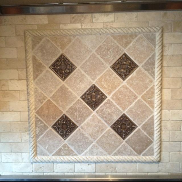 Close Up Of Square Backsplash Tile Inset Chiaro Travertine With Bronze Inset Tiles And Travertine