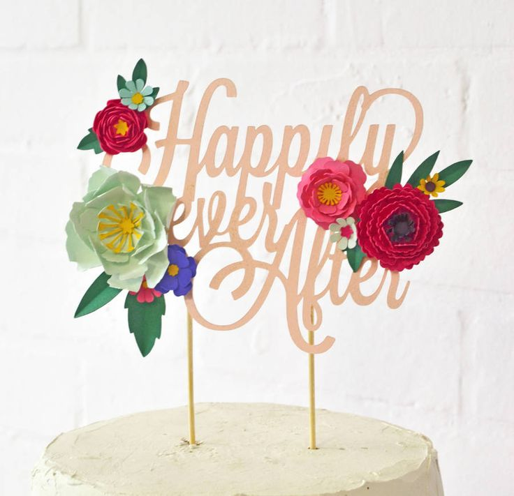 Handmade 'Happily Ever After' Paper Flower Cake Topper. The colours are customisable so you can match it to your theme, just choose from the 40 colours available! They are handmade in east london, and all the flowers are individually curled and folded.