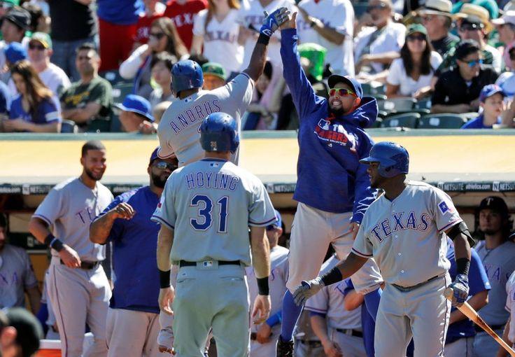Elvis Andrus celebrates his two-run homer in the second inning Saturday, Sept. 24, 2016, in Oakland. (AP Photo/Marcio Jose Sanchez)