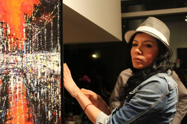 """SoMa Gallery owner Meyvis Araniva putting a red """"Sold"""" sticker on one of my works."""