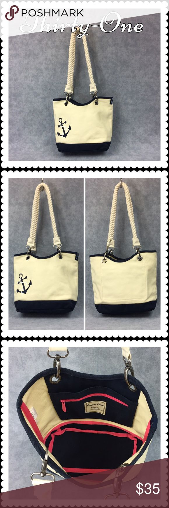 👜 Thirty One Canvas Crew Tote (4858) 👜 Thirty One Canvas Crew Tote (4858) 👜 With added rope and anchor. Canvas and Navy, come with original blue straps and the add-on rope straps as shown. In beautiful condition. Like new with only a minor mark on the outside (will add photo). One inside slip-in pocket and zippered pocket. Top has blue straps to tie closed. Incredible bag!  (Mini version also available. See separate listing) Thirty-One Bags Totes