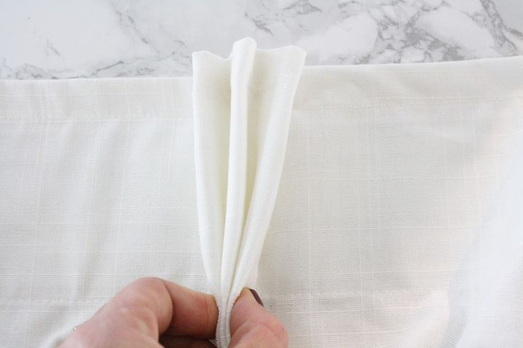 Tried of the flat RITVA curtains? Crane Concept has a fantastic tutorial on turning them into classic pinch pleat curtains, with an added Greek key trim.