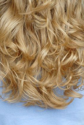 """A body wave perm is the perfect solution for hair that just hangs in front of the face, limp and boring. Body wave perms aren't about """"poodle curls"""" or even long spiral curls. A body wave perm is all about body, volume and oomph."""