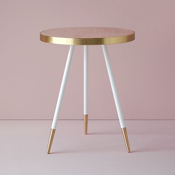 Bethan Gray's marble Band tables are edged in brushed brass