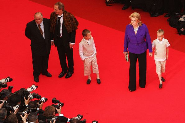 Catherine Deneuve Photos - Actress Catherine Deneuve (2R) arrives at the Un Conte De Noel Premiere at the Palais des Festivals during the 61st International Cannes Film Festival on May 16 , 2008 in Cannes, France. - Cannes 2008: Un Conte De Noel - Premiere