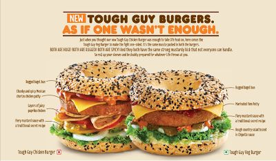 """Dunkin' Donuts India -  The Tough Guy Chicken Burger's key features are a """"Rugged"""" bagel bun (apparently """"rugged"""" means it comes topped with black and white sesame seeds), a Mexican chorizo chicken patty, sliced paprika chicken, fiery mustard sauce. Also along for the ride is a slice of cheese and veggies. Instead of chicken, the Tough Guy Veg Burger comes with a breaded yam patty and a """"rough"""" country salad tossed in chipotle sauce. The rest is the same as you'd find in the chicken version."""
