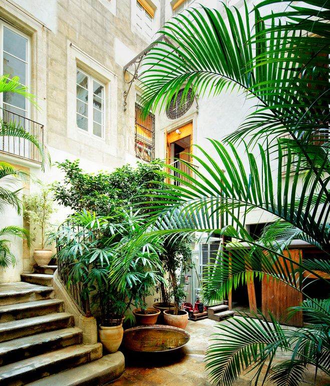 Love this green entrance to a renovated 18th-century home in Barcelona via Dwell