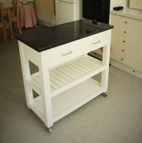 handmade available on Etsy UK #kitchen #island #butchers #trolley in #eco-friendly #solid #wood painted fresh #white with #granite #worktop available to buy on #Etsy #UK prices from £380, designed by Marc and #handmade by our small team at #MarcWoodJoinery #Somerset #UK #custom sizes on request. #design #country #traditional #cookery #home #living #slow #artisan #style #eco #rustic #industrial #interiordesign #baking #cook #vegetable #house #cottage #farmhouse #wooden #ideas #wheels #storage
