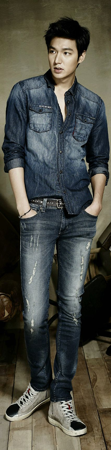 The photos show the actor looking suave as usual with his stylish hair and intense expressions. Lee Minho can be seen lounging on the ground, showing off his long lean body as well as going for the couple look with an equally good looking female model. Minho sports varying shades of denim clothing, pants and jackets alike, and matches them with fashionable, comfortable shirts.