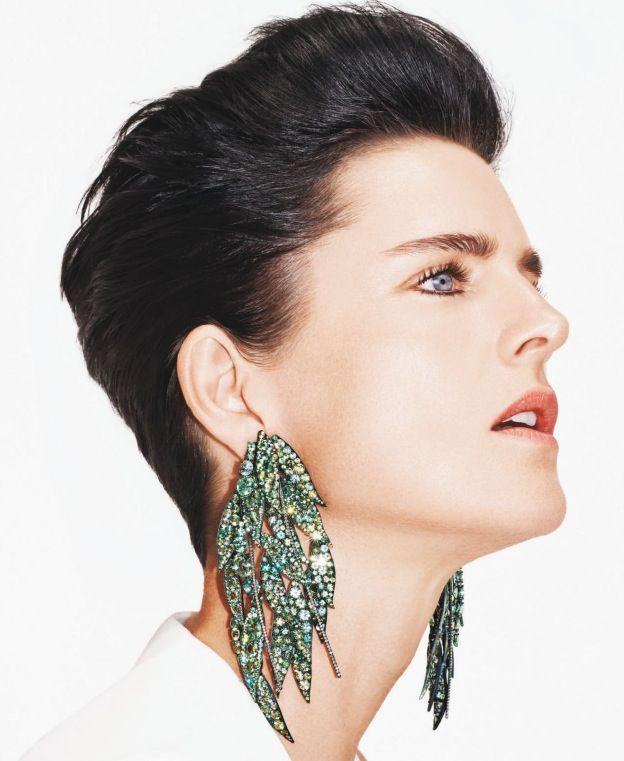 JAR - Stella Tennant wears weeping-willow pendant earrings of chrysoberyls and diamonds.