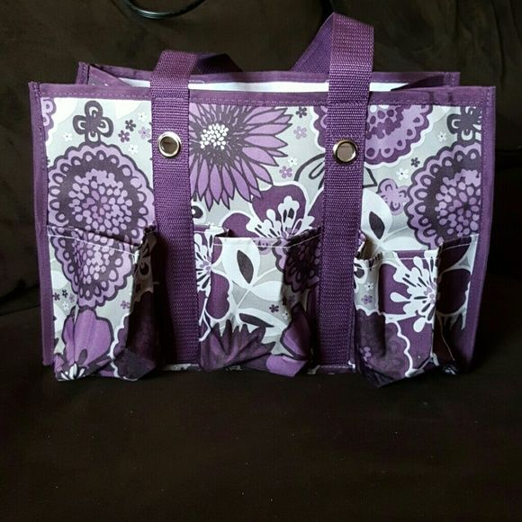 Thirty One Utility Tote New without tags purple/grey Thirty One brand Utility Tote: small run in fabric on back (see fourth picture) but doesn't take away from the beauty of this bag! Great for any number of uses and a modern color palette gives this bag a standing ovation! 3 pockets on front, 2 on back, and one mesh pocket on each end provides endless organization! Thirty One Bags Totes