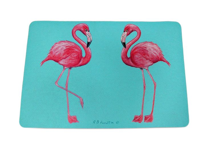Add a pop of coastal, tropical charm to the floor by the shower, the front door or kitchen with this colorful floor mat featuring a pair of bright pink flamingos. Made of synthetic washable materials, it`s sure to give you years of enjoyment while the non-slip rubber backing helps keep it in place, and the 1/4 inch thickness provides comfort and relief while standing. Measuring 18 inches (46 cm) wide and 26 inches (66 cm) long, it`s great for a pool area, laundry room or next to the bed or…