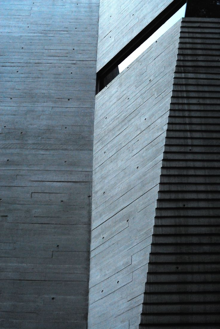 Looking at the way that wet concrete was poured against timber planks during construction. After concrete was set and formwork removed, it was left with timber grains as a texture on the building's surface. I used low light at dusk to highlight the narrow glass panel and the angles around it.