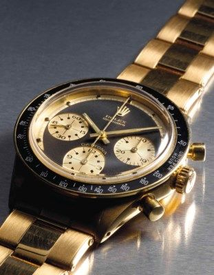 Rolex. An extremely attractive and probably unique 18K gold chronograph wristwatch with bracelet retailed by Hermes SIGNED ROLEX, COSMOGRAPH, DAYTONA, PAUL NEWMAN MODEL, REF. 6241, CASE NO. 1'947'352, MANUFACTURED CIRCA 1968 Price realised CHF 495,750 Estimate CHF 200,000 - CHF 400,000